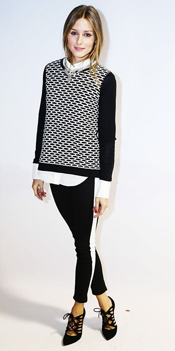 Olivia Palermo wearing a perfectly layered black-and-white look, with a statement necklace and strappy pointy-toe pumps.