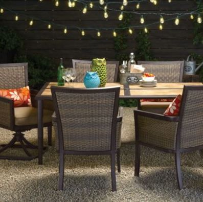 Inspired by this natural wicker patio set with string lights and bright outdoor accessories.