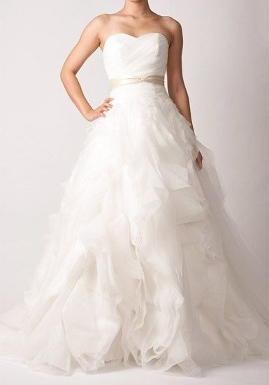 The perfect wedding dress but change the ribbon around the waist