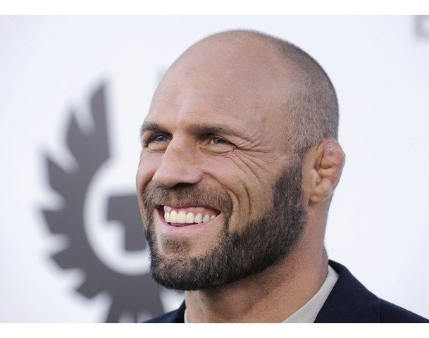 UFC fighter Randy Couture...is on DWTS this season? We might need to tune in to see this rugged manliness prance around the ballroom with Karina! He's all man. Nothing fem going on there. :)