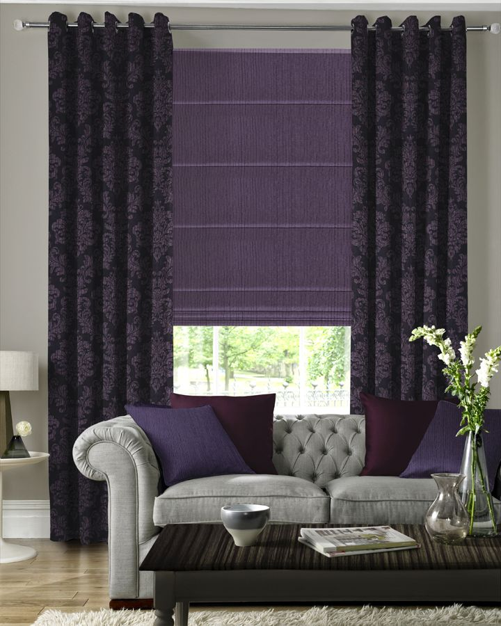 Nothing says luxury quite like a pair of sumptuous curtains at a window. Available in a number of style options, from pinch pleat to pencil pleat, with various additional finishes such as pelmets and tie backs, our range of made to measure curtains offer the ideal bespoke solution to any window. Here in dark purple and purple pattern with purple Roman Blinds