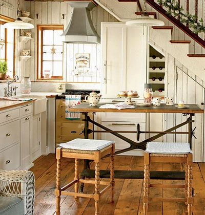 Reclaimed pumpkin pine make up these sleek hardwood floors, and the kitchen island was a roadside find, made from cast iron and wood.