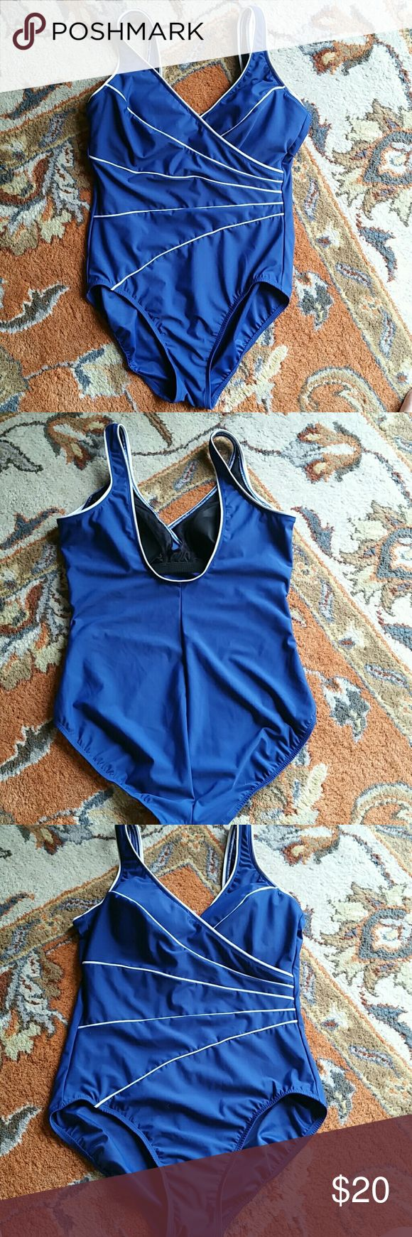 Kirkland miracle swimsuit size 12 Cute 70s look swimsuit size 12. Shows no signs of wear. Thick material light padded cups. Bust 18 inches across waist 14 1/2 hips 17 1/2 length 29 inches Vintage Swim
