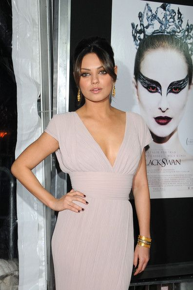 Hair Lookbook: Mila Kunis wearing French Twist (7 of 17). Mila Kunis added an elegant touch to her plunging neckline with a classic French twist complete with face framing bangs.