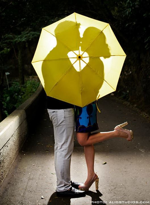 Have the couple kissing and the date written on the umbrella.
