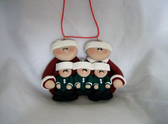 Santa and Mrs. Claus family with 3 little elves. This ornament would be ideal for a family of 2 adults with 3 children, or grandparents with