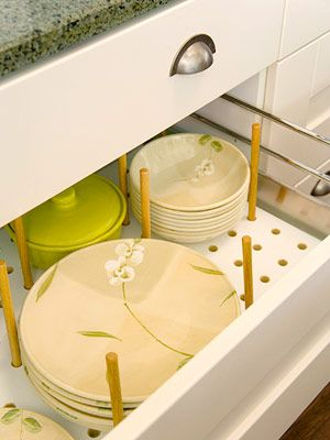 pegboard inserts can be sized to fit existing drawers and the pegs can be adjusted to secure stacks of bowls and plates.