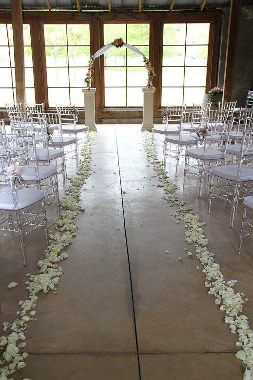 Archway with flowers www.wanakaweddingflowers.co.nz/gallery.php