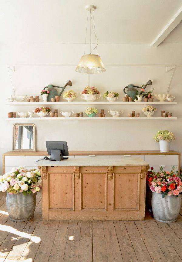 shelving behind the counter for any enticing containers to buy at last moment