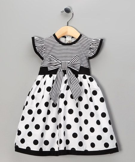 Perfect for being prompt to a party, this printed dress zips quickly up the back. It has a loose skirt in case a second helping of cake is necessary, while the bold print will look great in pictures.