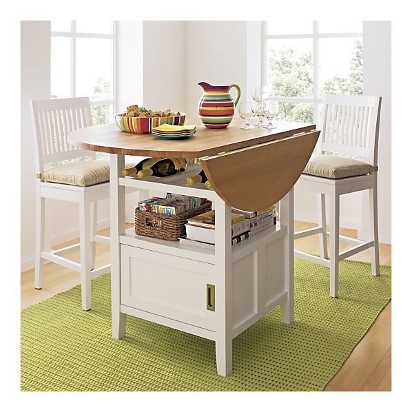 love this!  Like this one: drop leaf...combines open and closed storage for display/disguise...bar height for an instant eating surface....probably one of the more versatile island designs...could be made to any dimensions...could a butcher-block surface be adapted to this design?