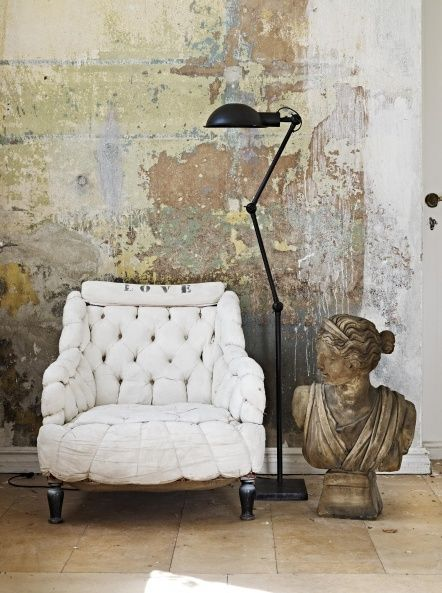 Love this funky chair and the great patina on the wall.
