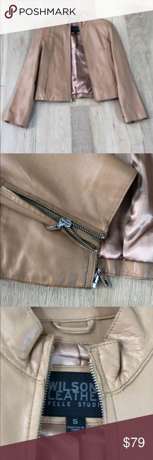 Camel leather Moto jacket Beautiful camel colored leather jacket in excellent condition. This 100% genuine leather jacket is the softest leather with zipper detail at the wrists and slit pockets in the front. Wilsons Leather Jackets & Coats