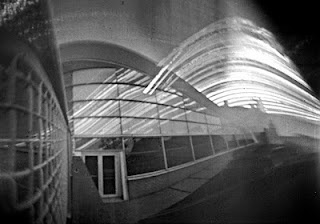 Solargraph Zeeuws Archief: archiefcafé, tuin, abdijtoren Lange Jan. Middelburg, 4 februari - 17 juni 2011. Pinholecamera: hoog smal blikje.  http://zeeuwsarchief.blogspot.nl/2011/12/nieuwe-gaatjescameras-dankzij-zeeuws.html