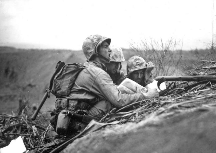 Advancing U.S. troops spot a Japanese machine gun nest ahead of them during the invasion on Iwo Jima - AP Photo