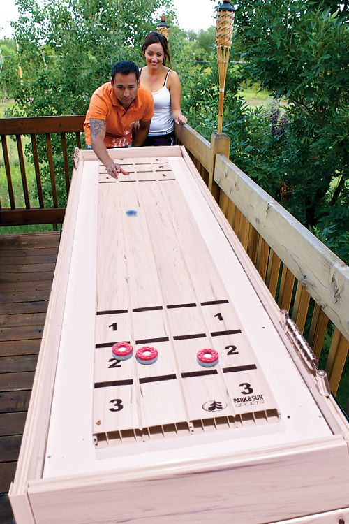 Park and Sun Sports - Outdoor Game Table Series - Blue Sky Shuffleboard Table Action