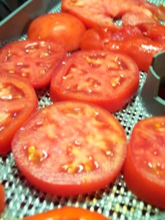 Drying Tomatoes. ummm buying a dehydrater just for this!