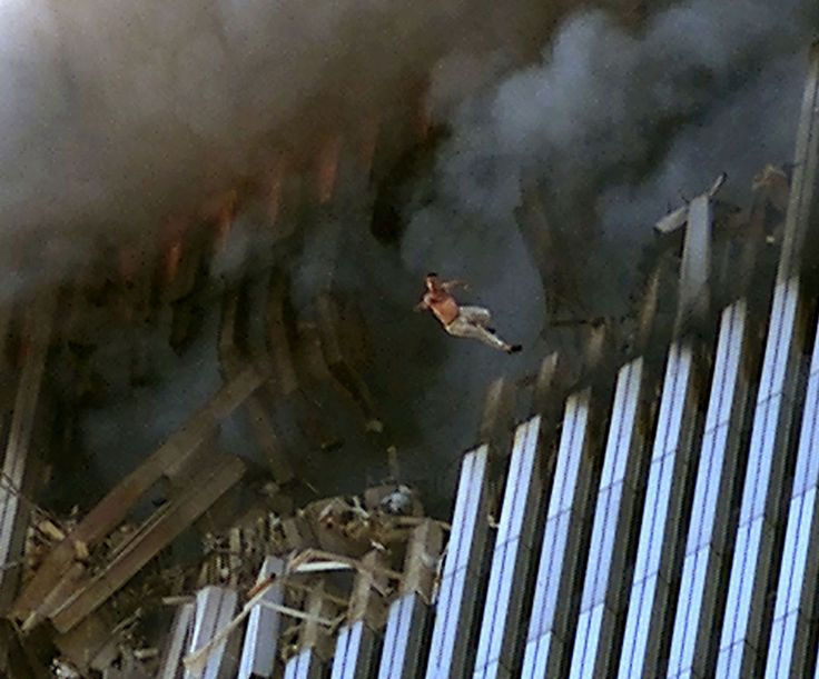 A man leaps to his death from a fire and smoke filled North Tower of the World Trade Center, on September 11, 2001 in New York City after terrorists crashed two hijacked passenger planes into the twin towers. (Jose Jimenez/Primera Hora/Getty Images