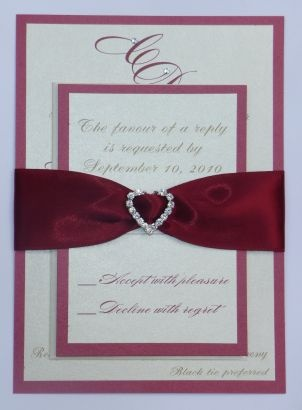 Double Layered Wedding Invitation Bottom Layer Is A Deep Red Metallic And Top Cream Bride Grooms Initials Are Adorned Wit