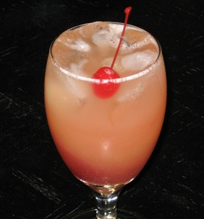 Ruby Relaxer (1 oz. Vodka 1 oz. Peach Schnapps 1 oz. Malibu Coconut Rum 3 oz. Pineapple Juice 2 oz. Cranberry Juice Cherry for garnish)