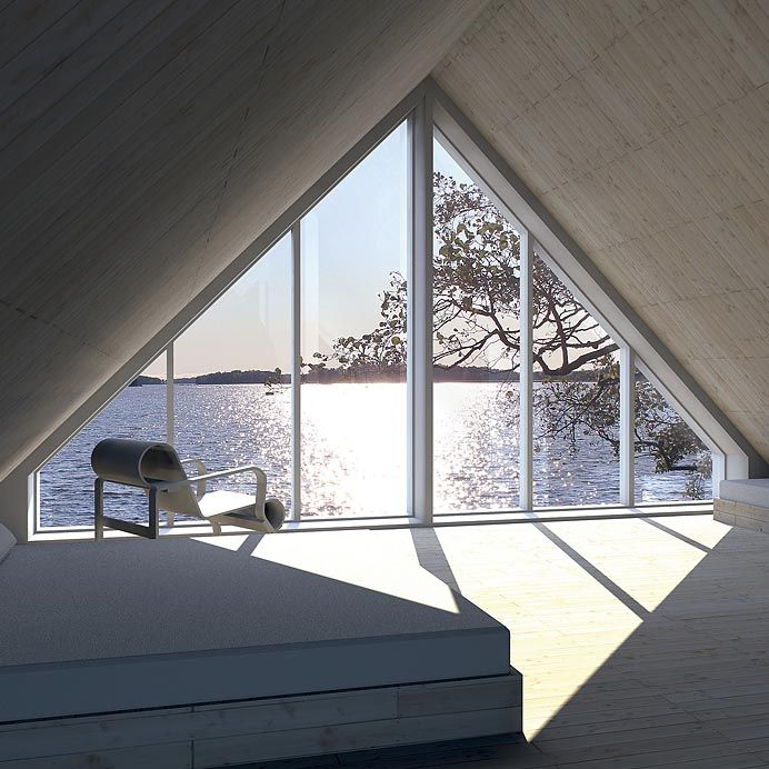 A place for quiet reflection. Interior of pre fab Sunhouse from Finland. Exterior of cottage is entirely black.