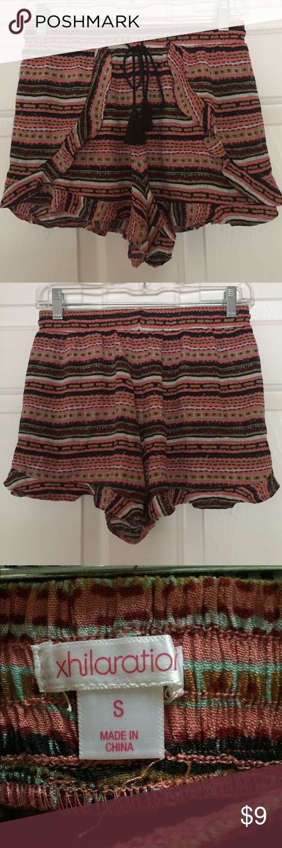 Aztec print summer shorts with ruffle trim Small Summer beach shorts with cute Aztec prints size Small. Ruffle trimmed. Brand is Xhiliration. Fabric Rayon. In new without tag condition. Perfect for this upcoming summer! Thanks for looking bundle and save! Price is firm unless bundled. Xhilaration Shorts