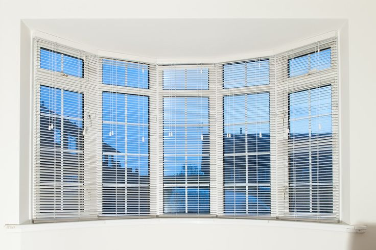 Wood venetians with strings for a 5-bay window in London.