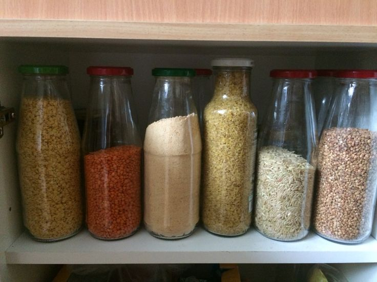 Reused tomato jars for store cereals, beans, flour...