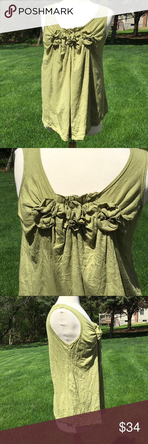 Chalet Crinkle Tank Top Taupe colored, Soft, lightweight, crinkled design with 3 rosette details along front neckline. Loose fitting, flowy at the bottom. Care tag has been removed. Excellent condition, worn once. 38% cotton, 50% polyester, 12% rayon. Chalet (Boutique Brand) Tops Tank Tops