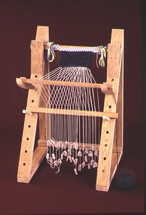Smith College Museum of Ancient Inventions: The Warp-Weighted Loom  card woven warp visible at the top