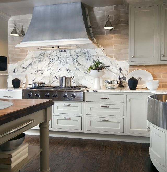 Book Matched Slabs Of Marble Under Range Hood On Top Of
