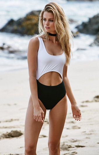 Make a splash the Kendall & Kylie way in the Cutout One Piece Swimsuit. Soft, stretch fabric, a black-and-white color palette and cutout detailing lend fashion and form to this one piece swimsuit. One piece swimsuit Unpadded Cutout detailing at the front and back center waist Skimpy seat coverage Model is wearing a small Model's measurements: Height: 5'8'' Bust: 34'' Waist: 24'' Hips: 34'' 80% nylon, 20% spandex; Lining: 10...