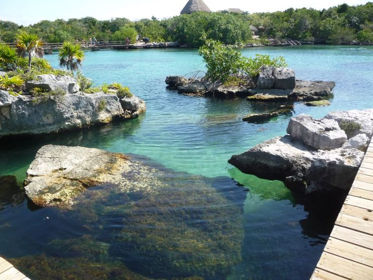 Beautiful clear water at Xel-Ha, a natural aquarium park where you can go tubing, snorkel, Snuba, Sea Trek, or swim with dolphins is south of Akumal, Cancun, Riveria Maya, Mexico.   Go to http://www.yourtravelvideos.com/view.php?view=121062 or click on photo for video and more on this site.