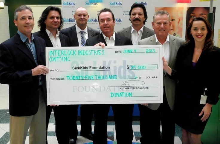 2013 - Interlock Industries (Ont) Inc. present a $25,000 check to the Ontario SickKids Foundation.