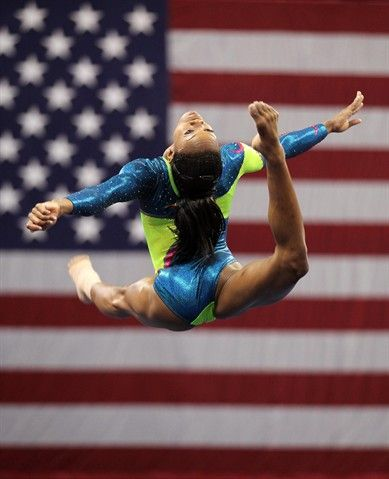 Gabby Douglas warms up during day two of the 2012 Gymnastic Championships in St. Louis. NBC Olympics