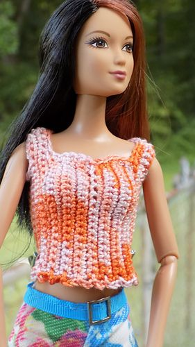 A T-Top for Barbie or similar size fashion doll. The top is worked sideways from the middle back around and overlaps in the back and fastens with snaps.