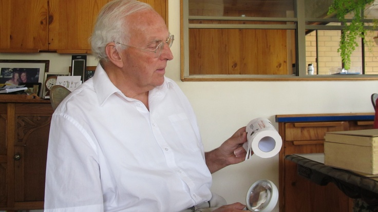 Professor John White - MA DPhil (Oxford), CMG MSc (Sydney), FRSC, FRACI, FAPS, FAA, FRS, examining a roll of Micah Challenge's toilet paper. He is well known and respected in scientific communities around the world, and absolutely supports the need for access to clean drinking water for everyone.