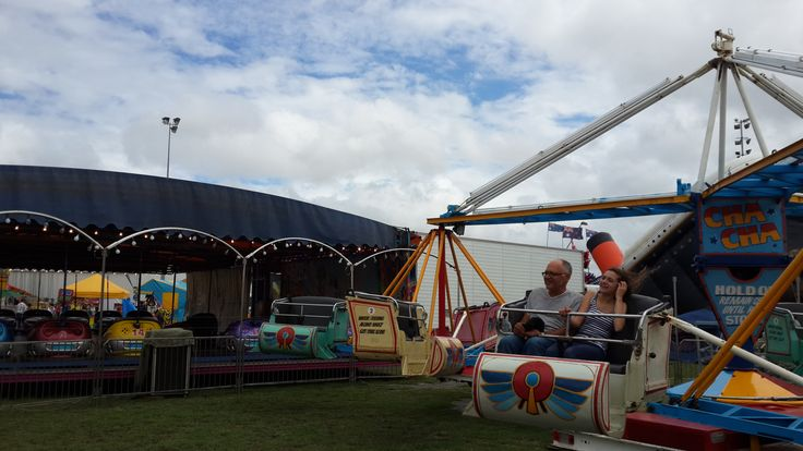 Two people enjoy the CHA CHA ride at Newcastle Show!
