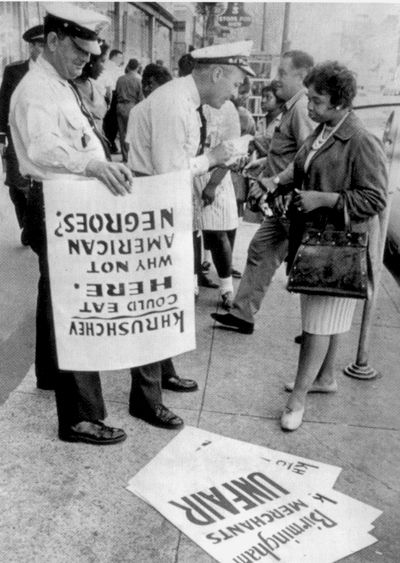 "Birmingham, Alabama, 1963. The upside-down picket sign reads ""Khrushchev could eat here.  Why not American Negroes?"""