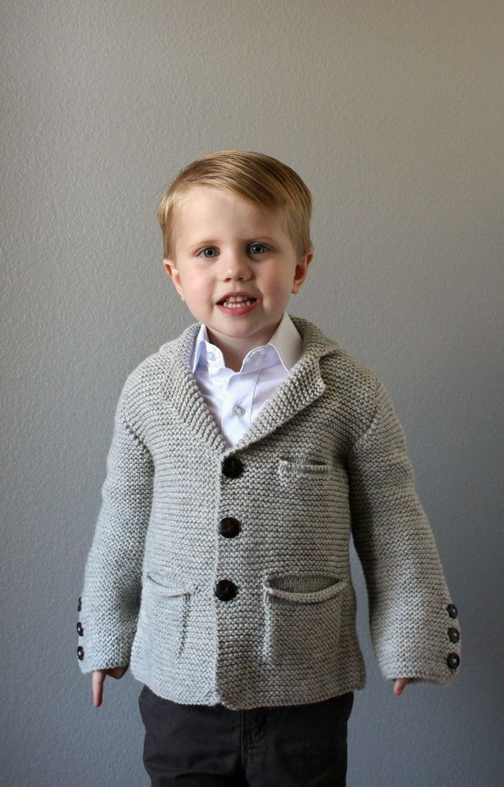 A handsome jacket for any little gentleman! Knit in squishy Garter stitch, this jacket is complete with all of the pleats, buttonbands, and pockets, of a traditional suit coat. The handsome notched co