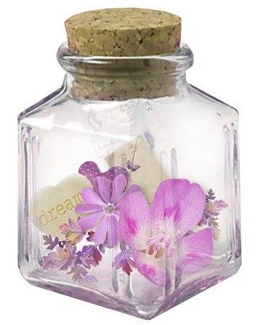 purple flowers in a glass bottle
