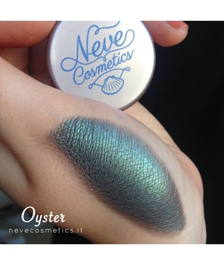 Oyster mineral eyeshadow. Transparent sepia black duochrome with turquoise-green shimmer