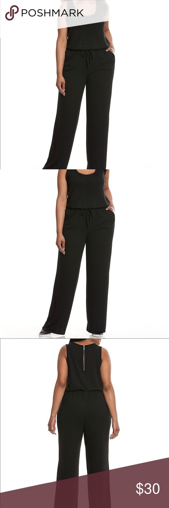 Scoop neck knit jumpsuit Livi Active's soft knit jumpsuit works a little wow into your wardrobe, keeping your look sporty-chic before and after your workout. Simple, single-piece styling makes this one a champ, with a flattering scoop neck, wide straps and a drawstring waist to define the fit to flatter curves. Slash pockets complete the look. Lane Bryant Pants Jumpsuits & Rompers