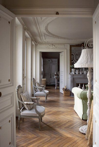 Gorgeous and French. I love the herringbone wood floors!