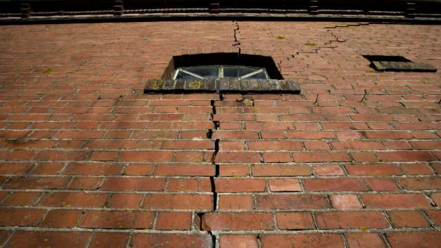 A crack in the wall of a farm in Hunzinge, northern Netherlands, Friday, Jan. 19, 2018. More than 3,000 homes in Groningen province are facing reinforcement or even in some cases demolition because of a series of small tremors caused by decades of gas extraction and the Dutch government is being forced to confront the possibility of a future without locally produced gas years earlier than expected. (AP Photo/Peter Dejong)