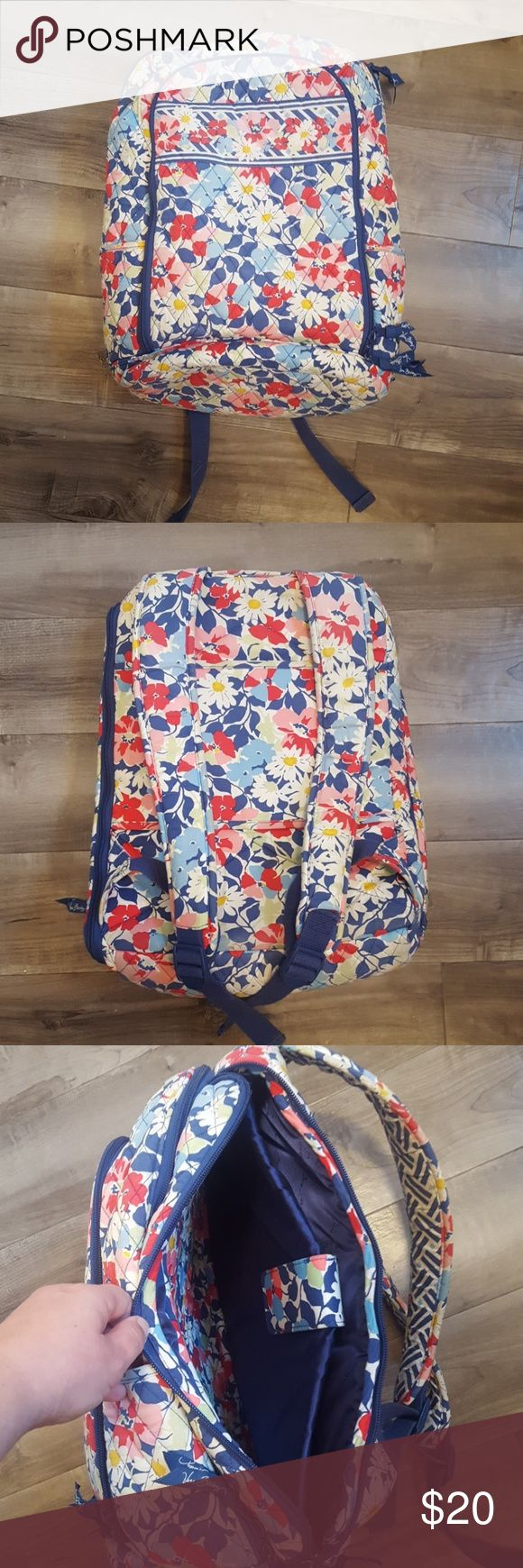 Vera Bradley laptop backpack Vera Bradley laptop backpack. Held my 17 inch laptop. Slightly dirty on bottom and front (have not tried to wash). Some wear on the bottom back of bag and small tear by strap adjuster (shown in pics). Vera Bradley Bags Laptop Bags