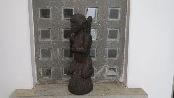 Antique tribal wood carving of a monkey with a human by Lallibhai