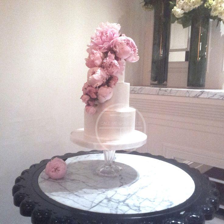 Lustre finish cake adorned in large fresh pink peonies.