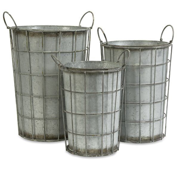 Balance robust industrial style and down-home, farmhouse flair with this understated flower vase set. Defined by a bold bucket-inspired design with openwork details and a timeworn silver finish, this set offers a dash of texture and rustic appeal to any space. Cluster the trio together in the guest suite to keep spare linens and rolled bath towels corralled in resort-worthy style, then add in factory-chic Edison bulb wall sconces and timeworn wood chests around the space to punch up the…