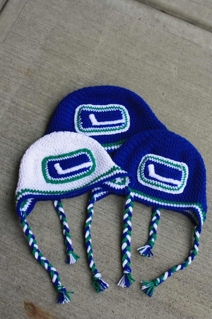 Great ready for the 2012 playoffs- Vancouver Canucks Inspired EARFLAP Beanie. $30.00, via Etsy.